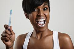 Woman with a tooth brush is screaming Stock Photos
