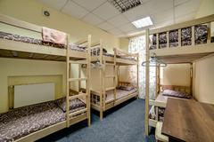 Small hostel room with bunk beds Stock Photos