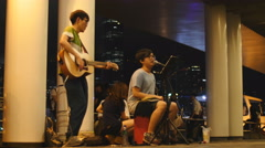 Young buskers in Hong Kong entertain 4K Stock Footage