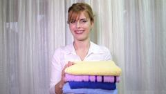 Stock Video Footage of Young Woman Fresh Smelling Towels
