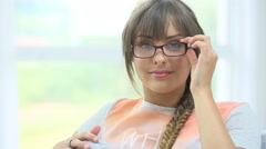 Young woman wearing trendy eyeglasses Stock Footage