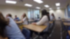 College students at their desks in classroom Stock Footage
