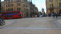 Unidentified tourists and locals  walk at street in center  of Oxford Stock Footage