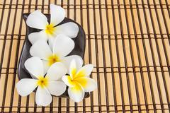 Tropical Plumeria and therapy on Bamboo Mat - stock photo