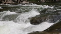 Mountain creek flowing water Stock Footage
