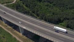 Aerial - Flying above the viaduct, tracking some traffic Stock Footage