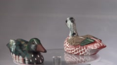 Wooden decoration ducks swimming around Stock Footage