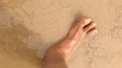 Male Leg in the Mud water - stock footage
