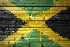 painted jamaican flag on a wooden texture - stock photo