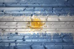painted argentinean flag on a wooden texture - stock photo