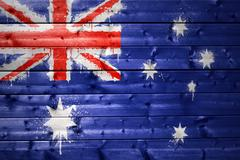 painted australian flag on a wooden texture - stock photo