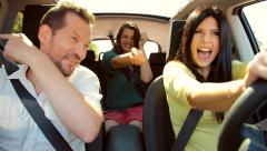 Beautiful people dancing and laughing in car in summer going in vacation - stock footage