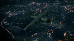 C130 flying through the night city Stock Footage