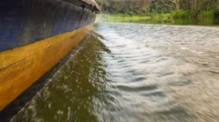 Wood speed boat riding in the river. Amazon, jungle, rainforest.Slow Motion. HD Stock Footage