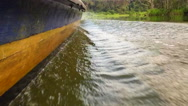 Stock Video Footage of Wood speed boat riding in the river. Amazon, jungle, rainforest.Slow Motion. HD