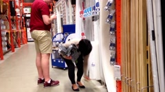 Couple shopping inside Home Depot store Stock Footage