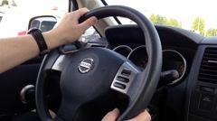 A man driving Nissan car Stock Footage