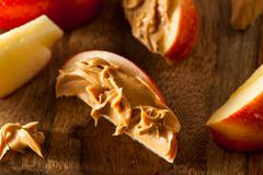 Organic Apples and Peanut Butter Stock Photos