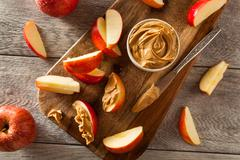 Organic Apples and Peanut Butter - stock photo