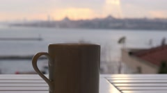 Slider, dolly coffee cup, background sultanahmet istanbul turkey - stock footage
