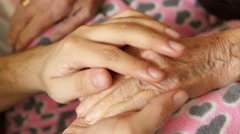 Grandson man holding hand of very old senior woman grandmother Stock Footage