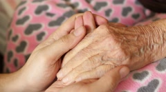 grandson man holding hand of very old senior woman grandmother - stock footage