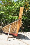Thai boat is manufacture right on the beach Stock Photos