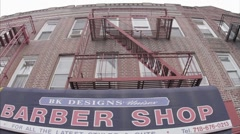 Exterior barber shop awning canopy sign Flatbush old vintage footage Brooklyn NY Stock Footage