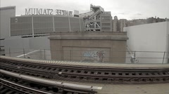 Subway train passing Yankee Stadium in South Bronx, black and white vintage NYC Stock Footage