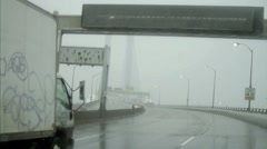 Truck driving Verrazano Bridge foggy rainy Brooklyn Staten Island NYC Stock Footage