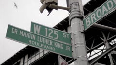 125 and Martin Luther King Blvd sign, gritty vintage archival film Harlem NYC Stock Footage