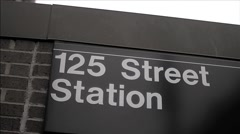 125 Street sign for 1 train at subway station in Harlem street, NYC Stock Footage