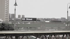 Elevated subway train platform, station at 125 street in Harlem, NYC Stock Footage