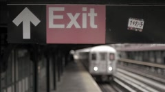 Gritty 35mm film footage 1 train arriving subway station platform Harlem NYC Stock Footage