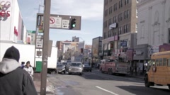school bus streets of Jamaica Ave Queens gritty old footage traffic people NYC - stock footage