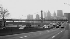 FDR Drive Brooklyn Bridge Manhattan Skyline black and white vintage film NYC Stock Footage
