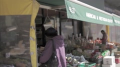 West Indian grocery store fruits vegetables black lady Jamaica Ave Queens NYC Stock Footage
