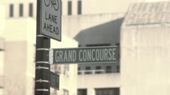 Grand Concourse sign in The Bronx in gritty vintage old film style footage, NYC Stock Footage