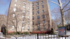 Queensbridge South Houses sign projects brick buildings ghetto NYC Stock Footage