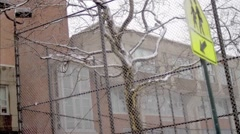 Hubert H. Humphrey Public High School Staten Island winter snowing gritty NYC Stock Footage