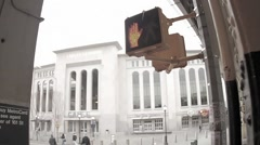 New Yankee Stadium exterior, coming out of subway station, rainy day, Bronx NYC Stock Footage