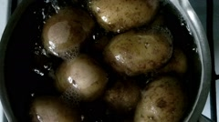 Potatoes simmering in boiling water - stock footage