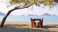 Turkish breakfast at beach by sea, fethiye, turkey - stock footage