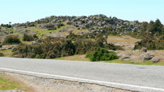 Empty road, rock formation in natural contryside, assos, canakkale, turkey Stock Footage