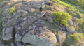 Slow fly over man  hiker tourist  standing on  hill top. Aerial  HD Footage
