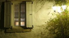 Retro window and street light at night Stock Footage