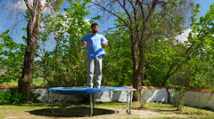 Happy man jumping playing on trampoline, freedom happiness concept Stock Footage