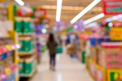 Blur of shopping at supermarket convenience store - stock photo