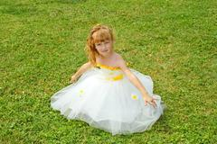 Girl in a festive dress on a lawn - stock photo