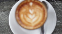 Cup of fresh latte on table Stock Footage